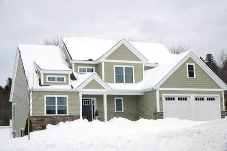 residential house after snow storm in winter Stock Photo