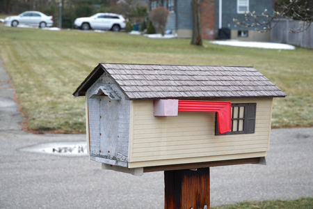 residential area: mailbox in house shape exterior in residential area Stock Photo
