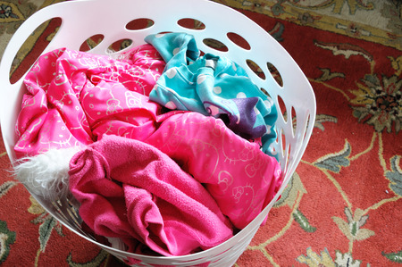 messy clothes: dirty clothes in the laundry basket