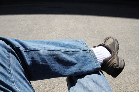 closeup on person sit relaxing with crossed leg
