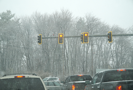 vehicles waiting in front of traffic light in the snowing day Reklamní fotografie
