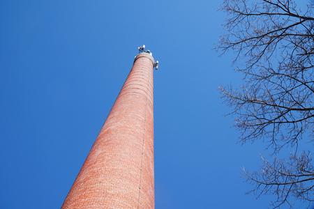 low angle view of brick chimney under blue sky 版權商用圖片