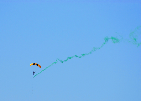 parachute show in the sky with color smoke