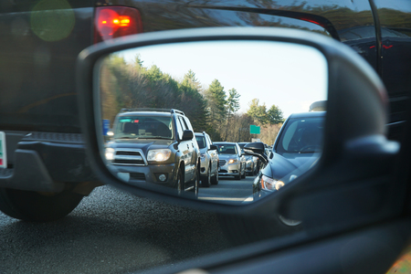 vehicles in a row during traffic jam from car mirror