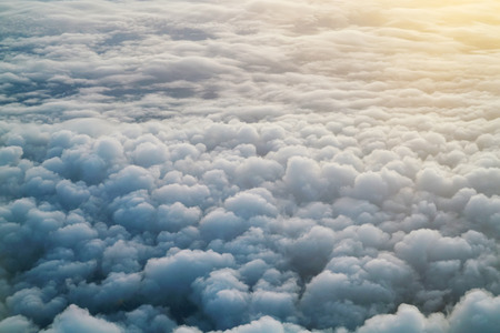 Aerial view of clouds background from airplane