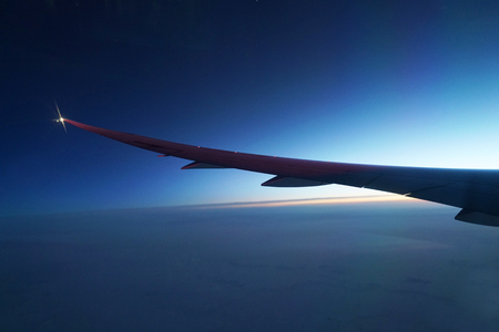 Airplane wing and twilight sky before sunrise Banco de Imagens