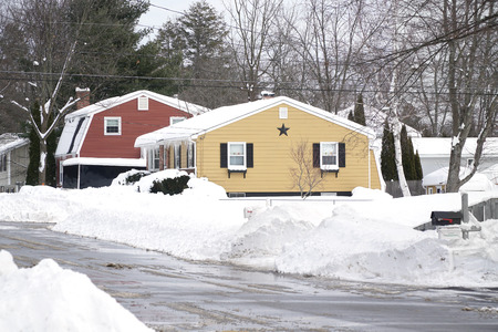 Colorful houses after snow storm in winter