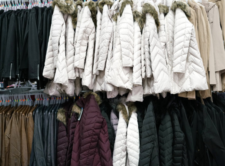 Hanging winter clothes in the store Stock Photo