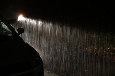 Heavy rain under headlight of vehicle at night