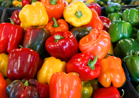 Close up on colorful bell peppers in harvest season in farm store