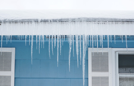 icicle hanging on house roof Stock Photo
