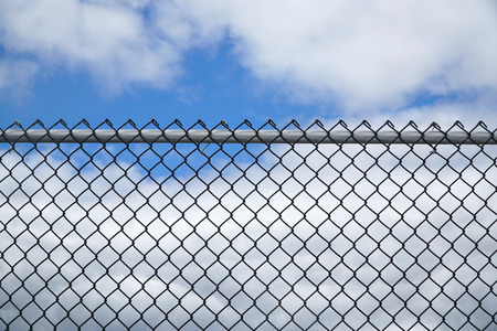 iron chainlink fence against sky
