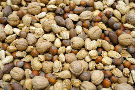 Close up on mixed nuts as food background