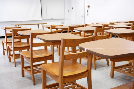 classroom with armed chairs in university Stockfoto