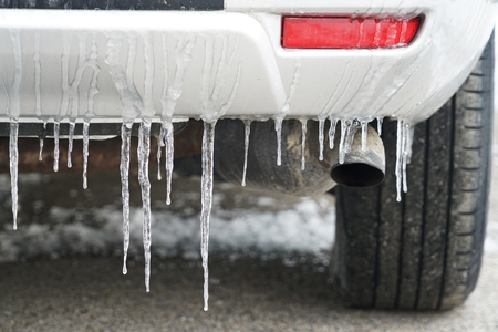 Close up on Icicle on the car in winter morning