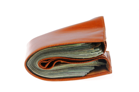 Wallet full of US dollar cash bills