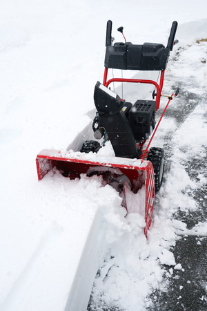 snow blower removing snow on the driveway