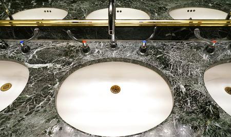 close up on ceramic sink with granite top in the bathroom Reklamní fotografie
