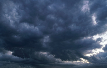 Storm cloud and dark sky before thunder storm Stock Photo