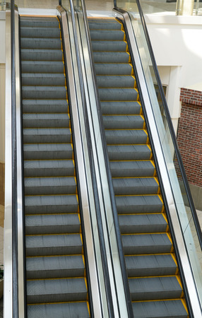 close up on escalator inside shopping mall Stock Photo