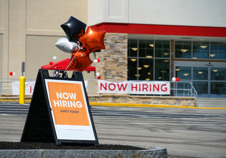 hiring notice on message board outside the store Stock Photo