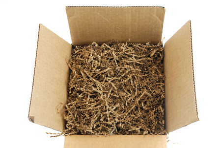 brown cardboard box with packing material Stock Photo