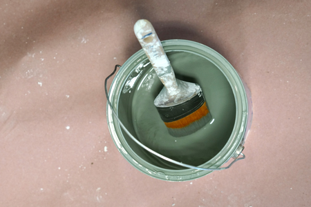 high angle view of painting brush in the can
