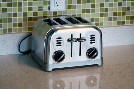 close up on toaster machine on kitchen counter top