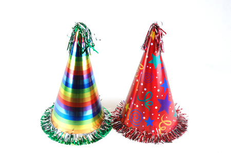 close up on colorful party hats isolated on white