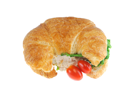 close up on chicken salad croissant roll isolated on white background 免版税图像