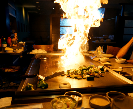 hibachi grill and fire flame in the restaurant