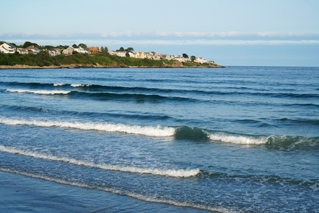 landscape of sea wave and York town in Maine
