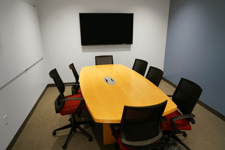 long meeting table and chairs in the meeting room