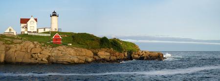 nubble lighthouse on the island under sunlight Stock Photo