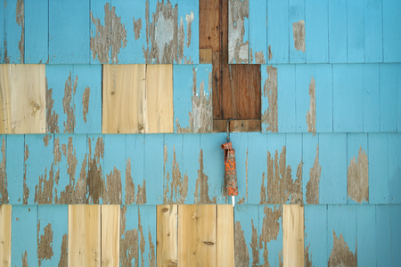 close up on house exterior wall with cedar wood panel repair