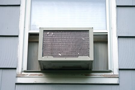old air conditioner installed on house window Stock fotó