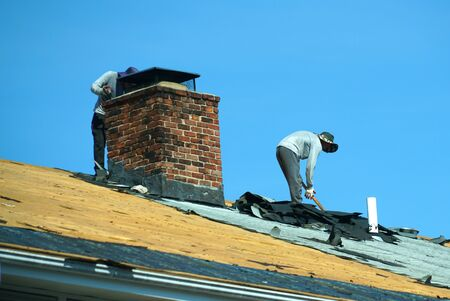 a group of worker repairing the apartment roof