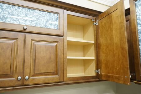 close up on wooden kitchen cabinet with door open