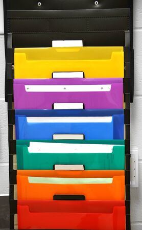 close up on colorful hanging document folder bags