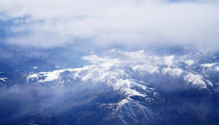 aerial view of snow mountains from airplane 版權商用圖片