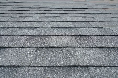 close up on new installed roof shingle