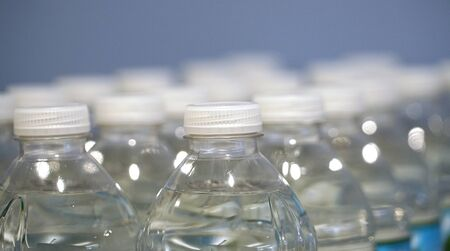 close up on transparent plastic bottle water Stok Fotoğraf - 128429964