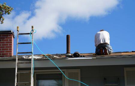 handy man working on repairing the roof
