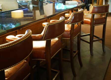 chairs in a row in the bar