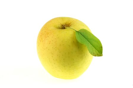 close up on golden delicious apples isolated on white background