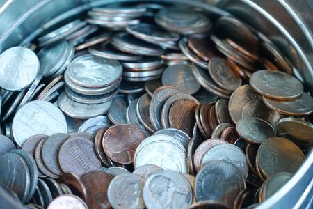 close up on the coins in the steel container 写真素材