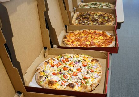 various pizza in boxes in a row for lunch 版權商用圖片
