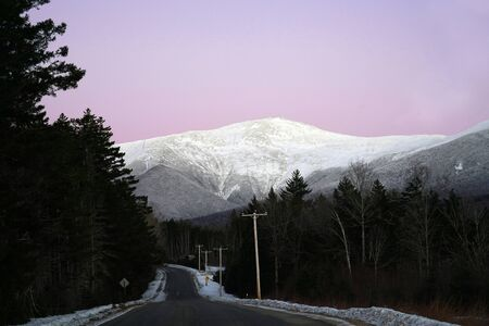 Mount Washington and country road under twilight sky with purple color