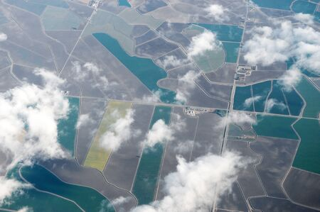 aerial view of the green field in country area with white cloud 版權商用圖片