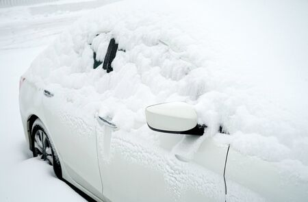 close up on snow covered car in winter